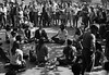5*Fri, Oct 25, 1968 *People: yoga group Subject:  *Place: sproul plaza, campus Activity:  Comments: Holy Hubert in R foreground.  Spectators really looked intently.